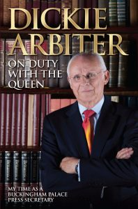 Dickie Arbiter Royal Expert and best known of all HM The Queen's former Press Secretary's Dickie Arbiter on the front cover of his book On Duty with the Queen. Dickie is standing with his back to a bookshelf full of history books