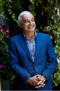 The Ivy Restaurant Director Fernando Peire photographed in a bright blue jacket and open neck shirt