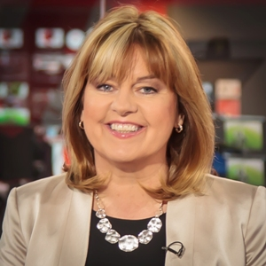 Maxine Mawhinney reading the news on the BBC