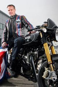 Owner of Iconic British Brand Norton Motorcycles Stuart Garner sitting on one of his Norton's.
