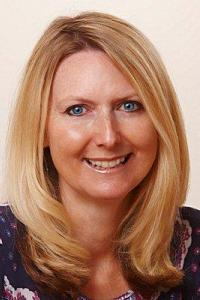 Sue Hayward head and shoulders photo with shoulder length blonde hair