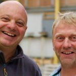 Chris Frediani & Julian Perryman smilingat the camera at a DIY SOS Job
